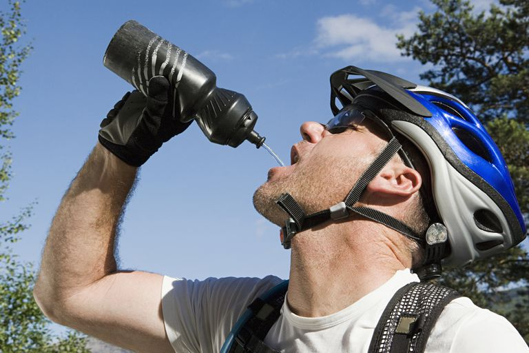 Biker drinking from a water bottle