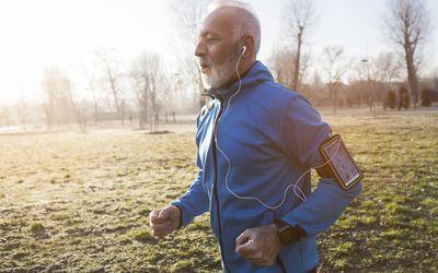 older man running in the park