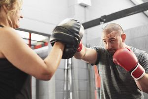Personal trainer working with boxer