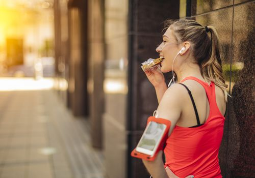 Runner eating a granola bar