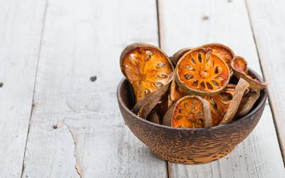 dried bael fruit in a bowl