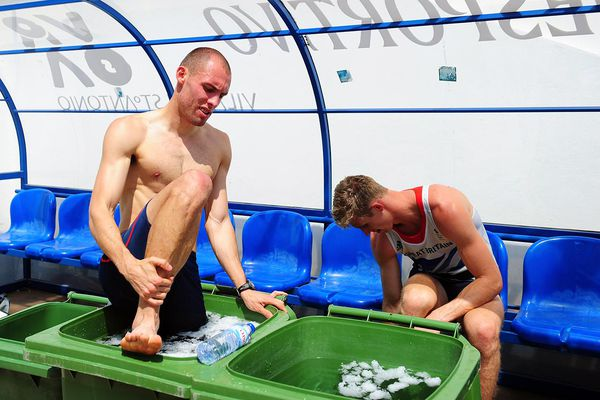 Hurdlers Dai Greene (l) and Jack Green take an ice bath after their training session during the Team GB Track and Field preperation camp at Monte Gordo Stadium on July 25, 2012 in Monte Gordo, Portugal.