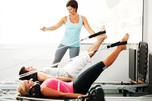 Pilates instructor working with students