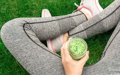 Girl drinking fruit smoothie after running