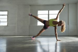 Woman doing variation of side plank