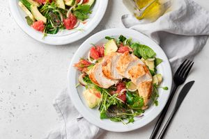 Grilled chicken over a salad.