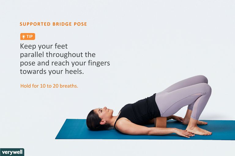 Woman Doing Supported Bridge Pose