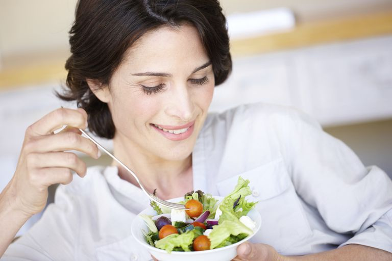 healthy eating habits - woman eating salad