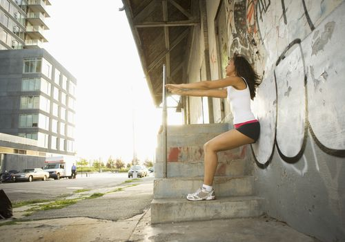 woman doing wall squat exercise