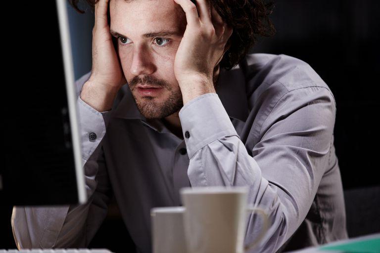 Sitting Stressed at Desk