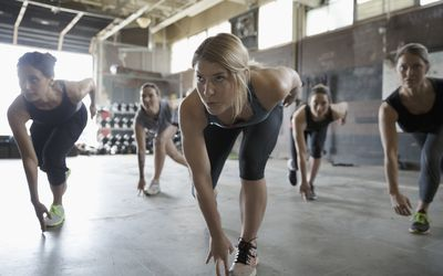 Focused women exercising in exercise class at gym