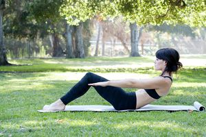 Woman practicing pilates in park