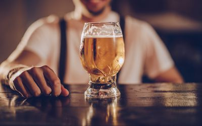 Beer in a glass on a bar