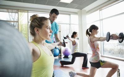 Women lifting weights in class