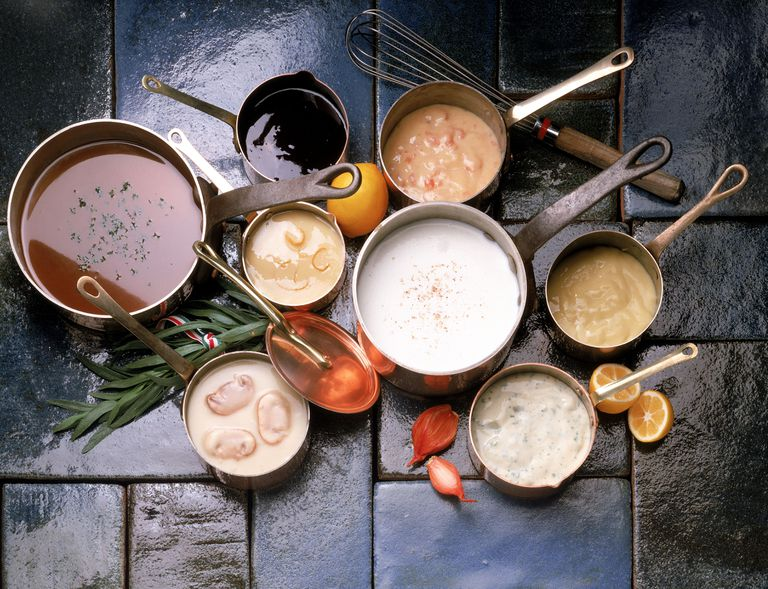 Assortment of soups in copper pots