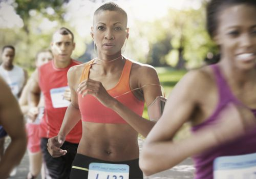 Black athlete running in a race