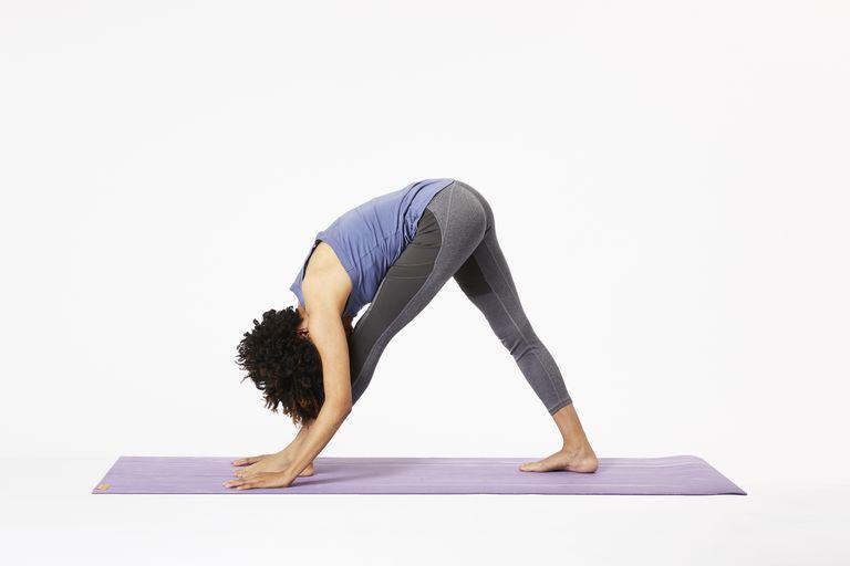 Woman doing pyramid pose on yoga mat