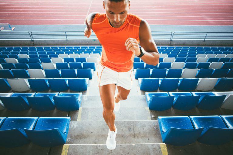 Man running up steps in stadium