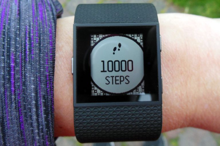 Close up of the Fitbit Surge10,000 steps congratulations message