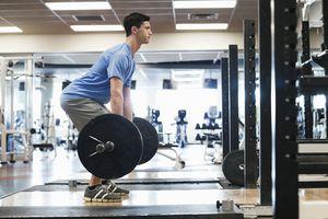 man doing deadlift in gym