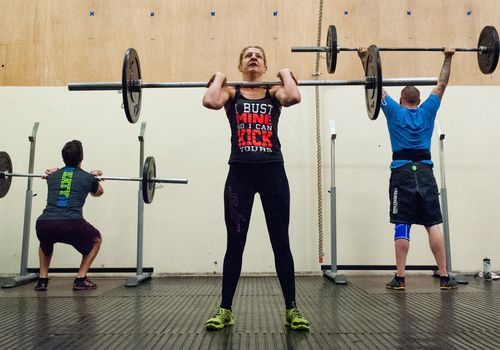 A woman doing a CrossFit Girl WOD