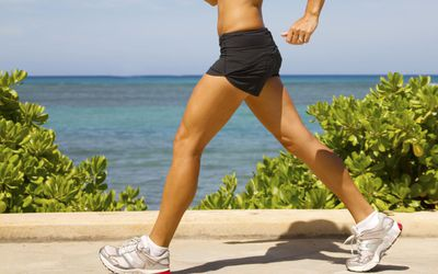 Brisk walking woman with good walking form
