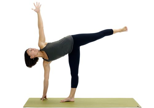 Woman doing half moon pose