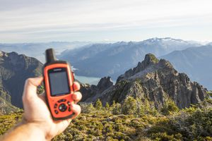 person holding a hiking gps in the mountains