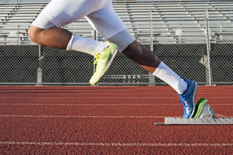 man starting running on running track