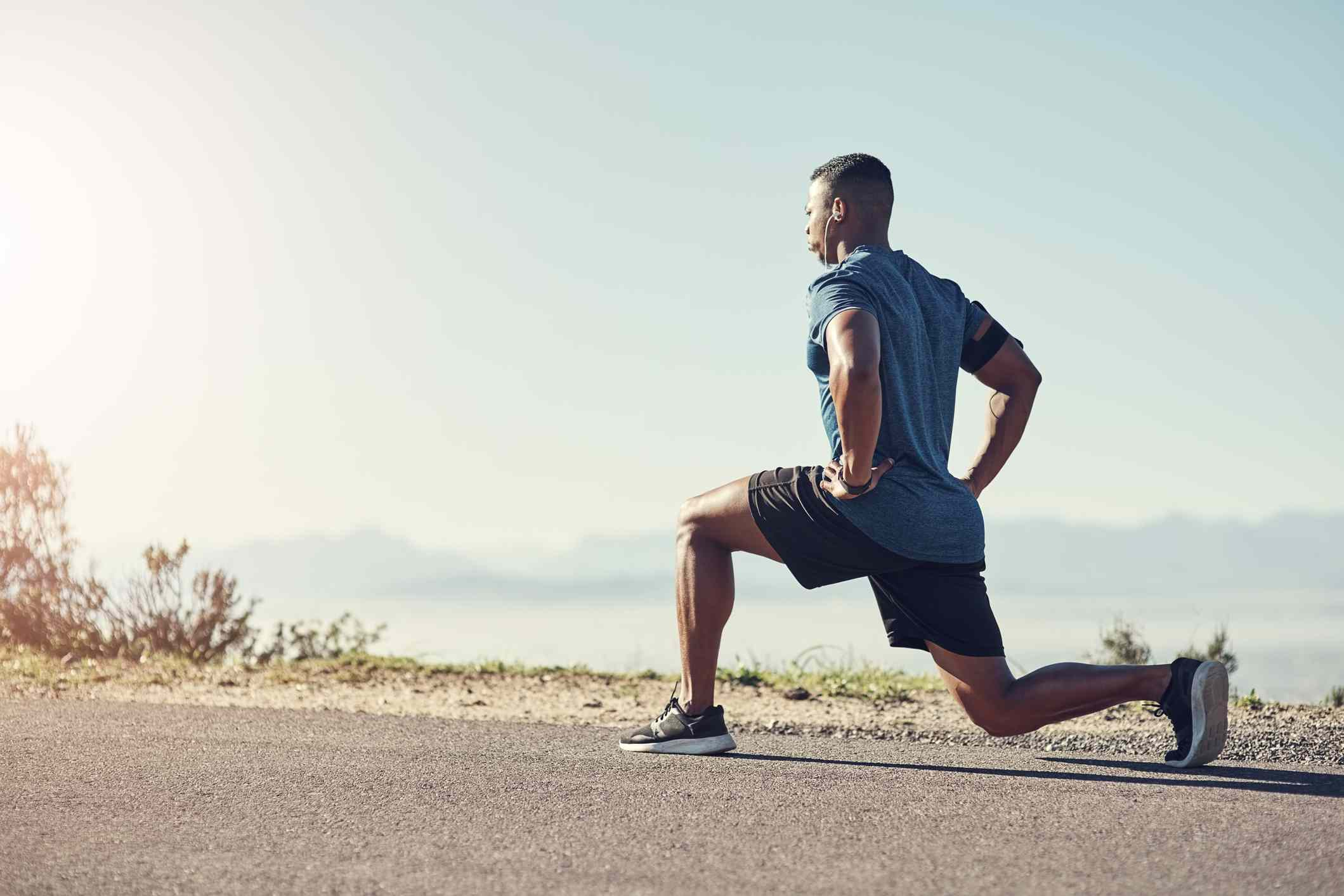 Man doing a walking lunge