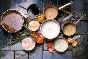 Assortment of soups in copper pots
