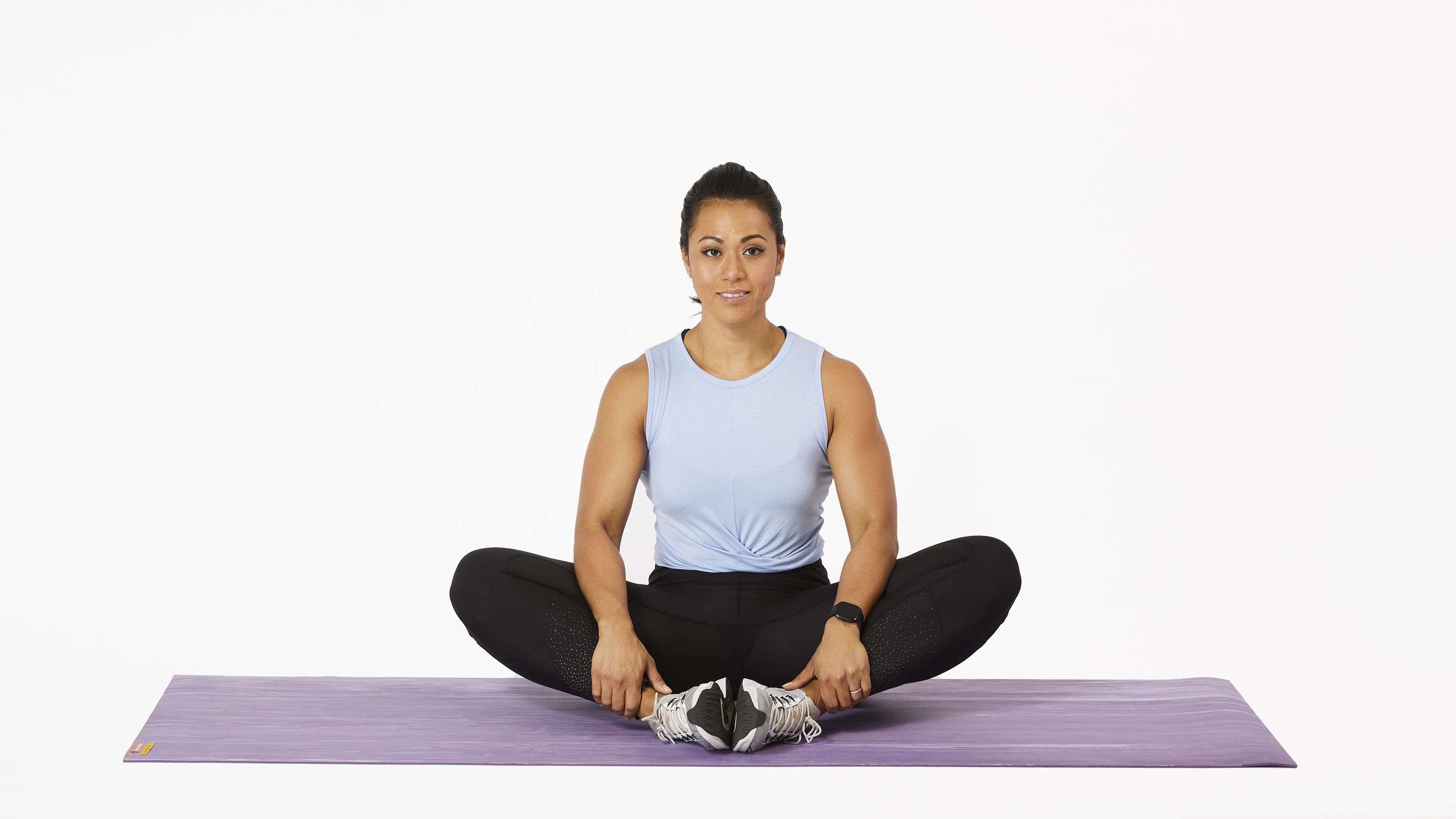 Woman doing a seated butterfly stretch