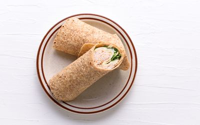 turkey and cheese sandwich in a wrap