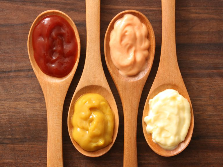 ketchup, mustard, and mayo on wooden spoons