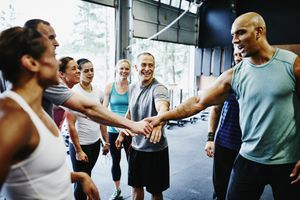 A group of CrossFit athletes gathers for a cheer.