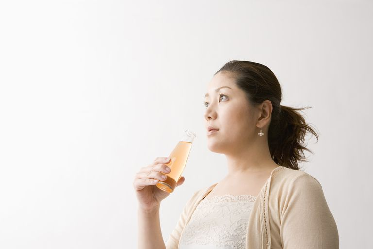 Woman with an energy drink