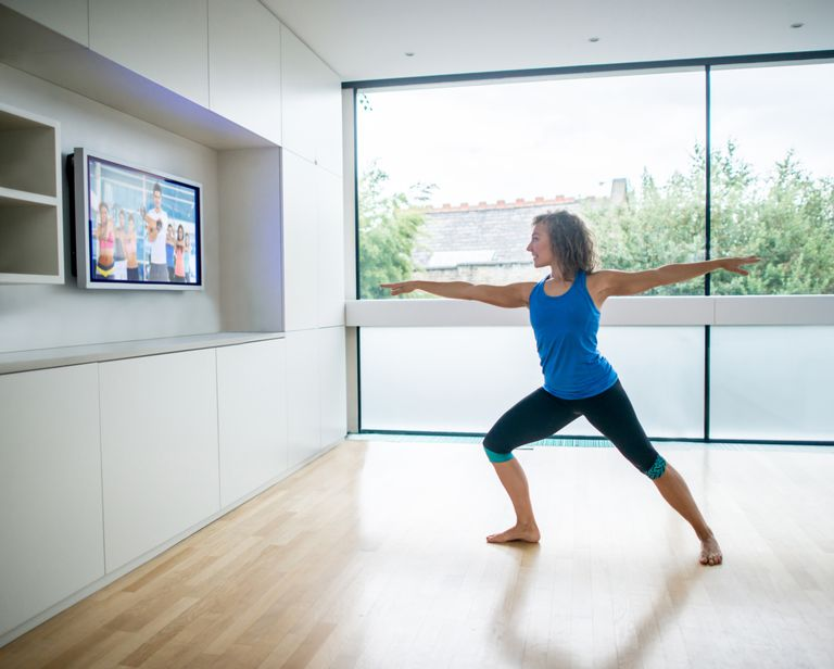 Woman doing yoga with video