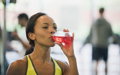 Young woman drinking sports drink