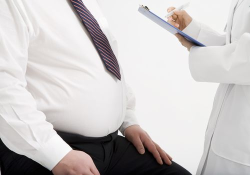 doctor and overweight male patient