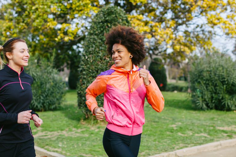 Woman running outside with a friend