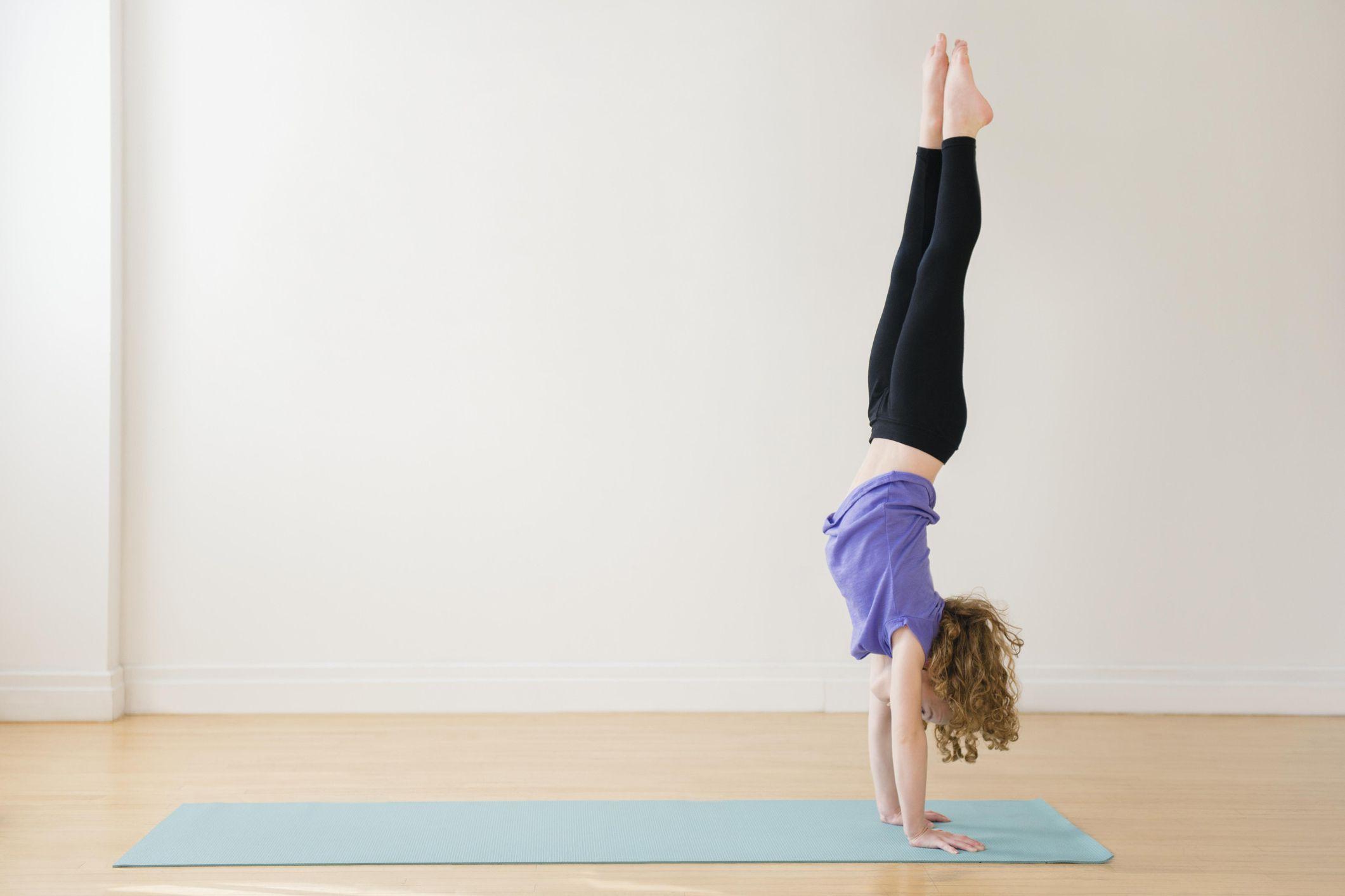 Parada de manos de yoga