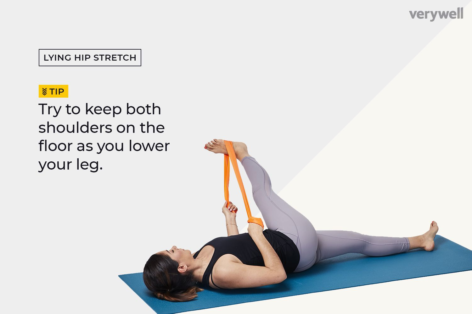 Woman doing an advanced lying hip flexor stretch with a resistance band