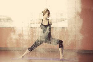 A woman practices Hot Yoga