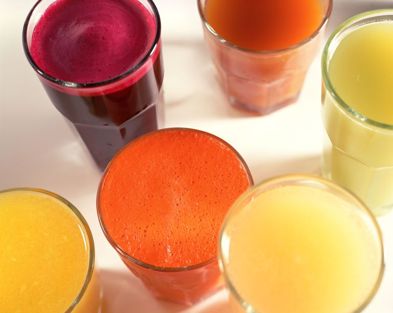 assortment of fruit juices in glasses