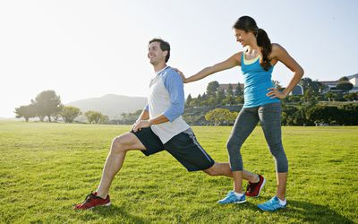 Couple stretching in the park