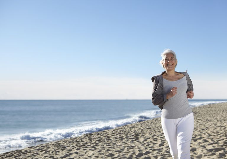 Mature woman jogging on beach
