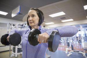 Woman weight lifting at gym