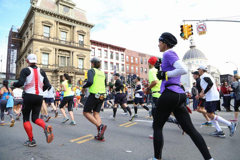 marathon runners crossing city street