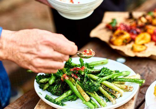 man eating asparagus