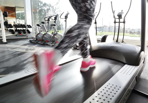 Woman's Legs Running on Treadmill